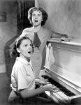 Judy Garland and Deanna Durbin Singing at Piano_c.1936
