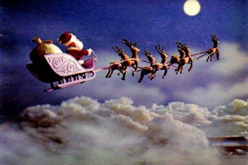 Santa's sleigh pulled by reindeer, Rudolph leading