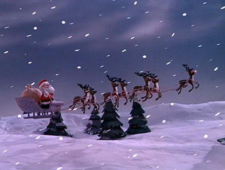 Santa in his sleigh pulled by reindeer, Rudolph leading (1)