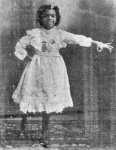 Undated childhood photo wearing (pinned to her chest) medals won in cakewalking  and  buck dancing competitions