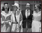 Ann Miller (in Kiss Me Kate costume), Cole Porter, Jack Cummings, and Kathryn Grayson -- c. 1953