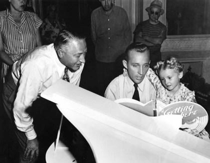 Bing Crosby and Karolyn Grimes, with director Stuart Heisler, set of Blue Skies (1946)