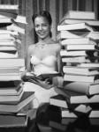 Dorothy Dandridge Reading Amid Book Pile