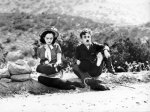 Charlie Chaplin preparing to wiggle the toes of his left foot, Modern Times (1936)_small, low res