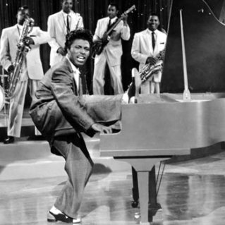 little-richard-1955-foot on top of piano