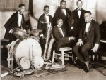 Washingtonians, c.1925: Sonny Greer, Charlie Irvis, Elmer Snowden, Otto Harwick, seated, Bubber Miley, Duke Ellington