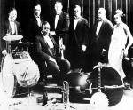 King Oliver's Creole Jazz Band_Baby Dodds, Honoré Dutrey, Bill Johnson, Louis Armstrong, Johnny Dodds, Lil Hardin-Armstrong. Sitting in the foreground King Oliver
