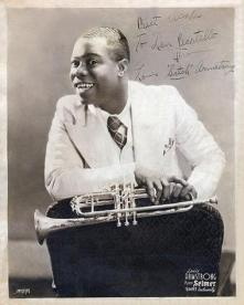 Louis Armstrong_inscribed_early photo_Selmer ad_sx1