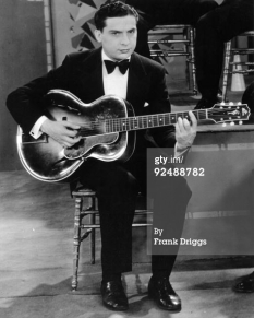 Eddie Lang performs with Gibson guitar, c.1928 in Chicago, Illinois