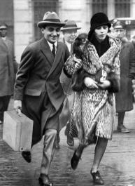 Irving Berlin and Ellin (Mackay) Berlin run toward Atlantic City train station to return to NYC post-honeymoon
